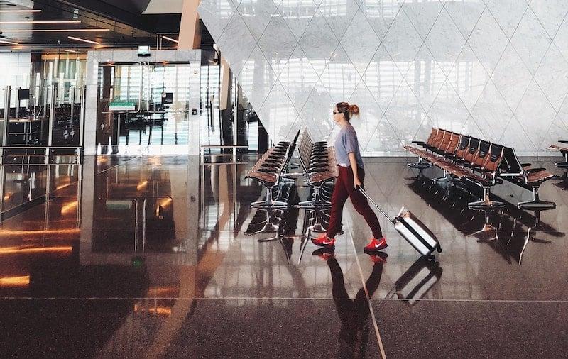 woman walks through airport