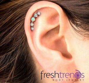 trailing stud single helix piercing