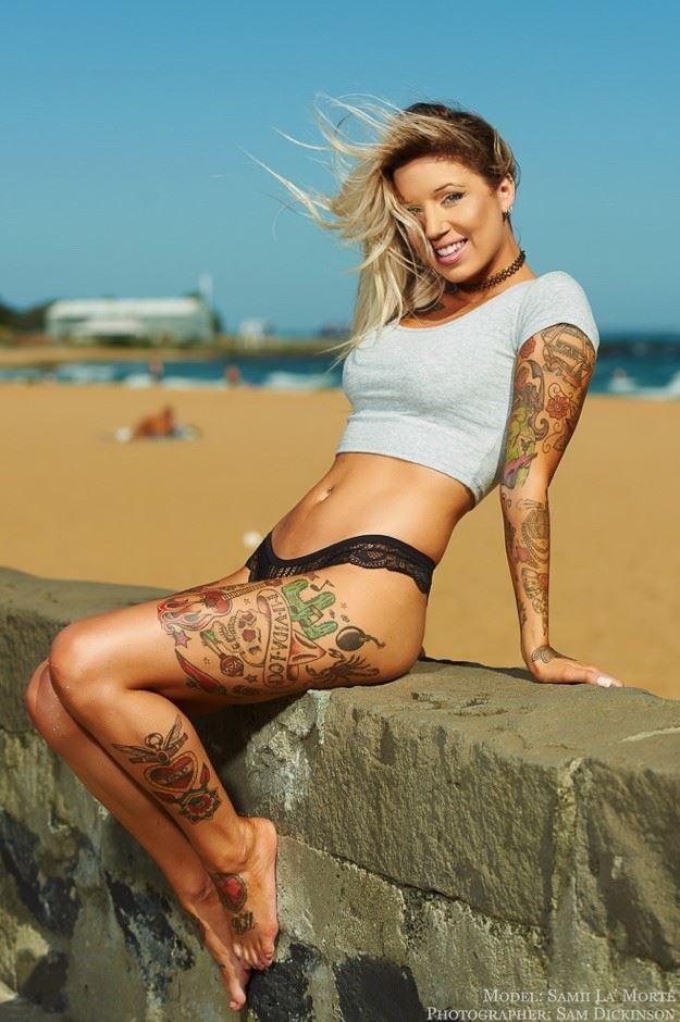 Tattooed girl on the beach