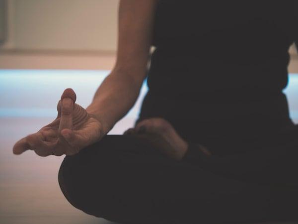 close up of person meditating