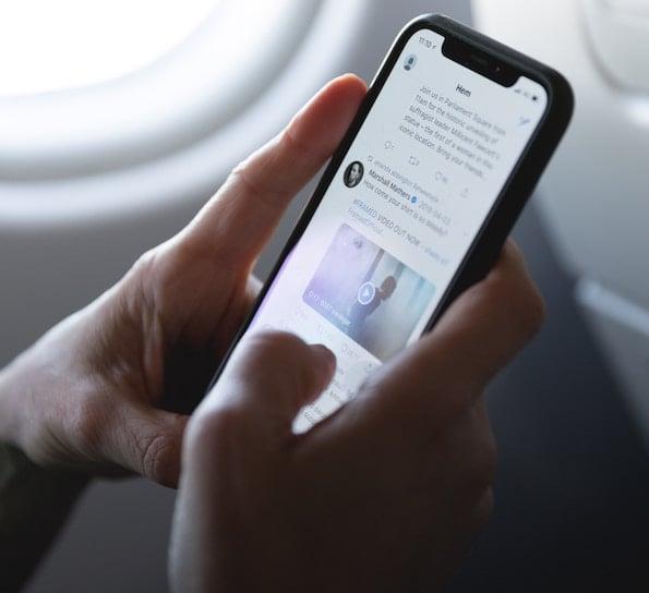 person checks social media on phone
