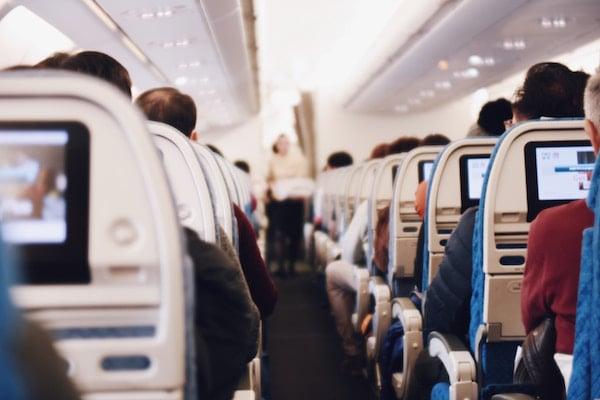 airplane aisle on a full plane