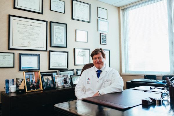Medical Doctor at His Desk