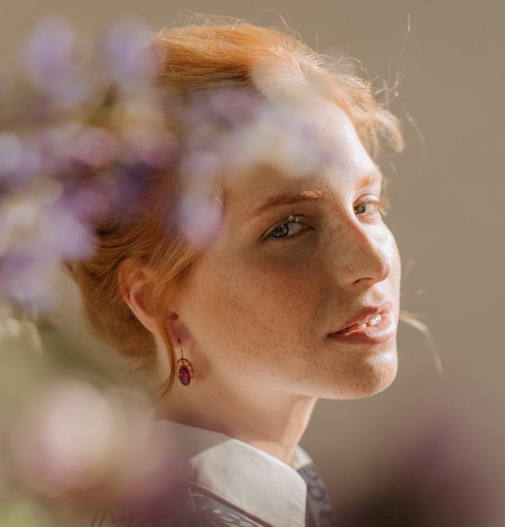 woman with garnet earrings